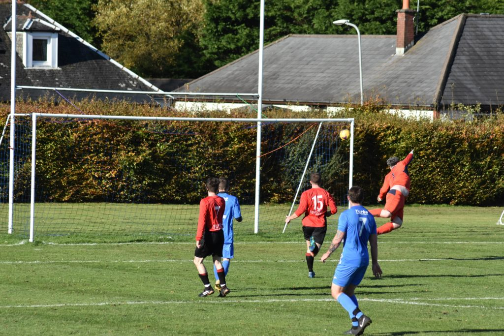 The Killie Athletic goalkeeper leaps into the air in an attempt to prevent another Arran goal.