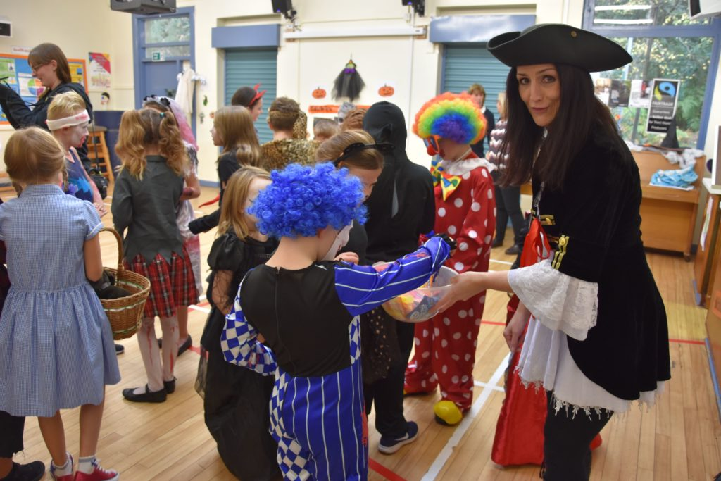 Mrs Anne Watts lets the children select a sweet treat during the Hallowe'en party.