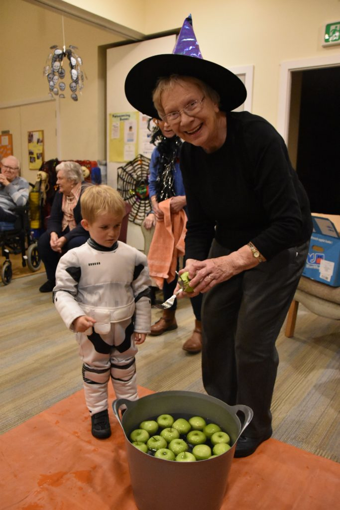 A young Star Wars fan dooks for an apple after his performance.