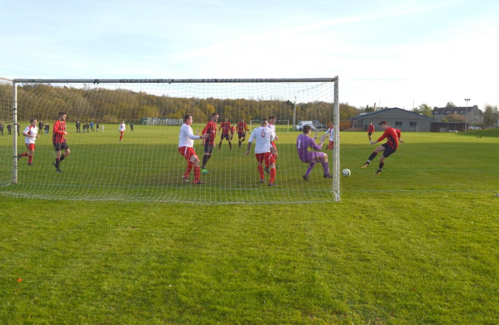 Grant Adamson powers the ball into the goal right in front of the Thistle goalkeeper.