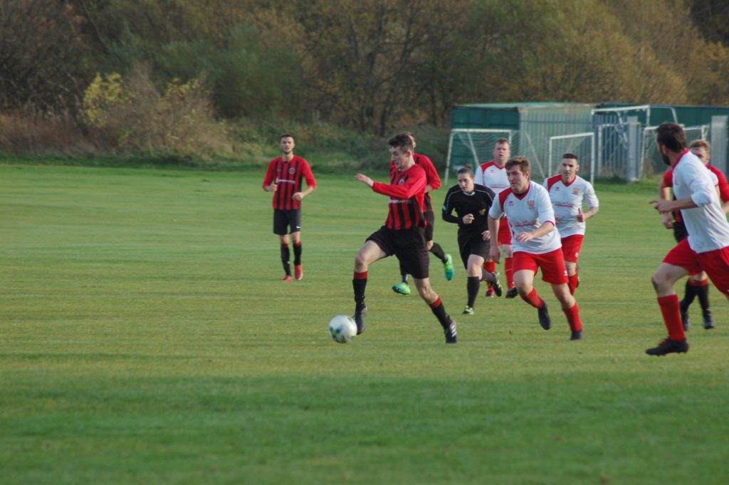 Johnnie Sloss accelerates away from opposition players with the ball.