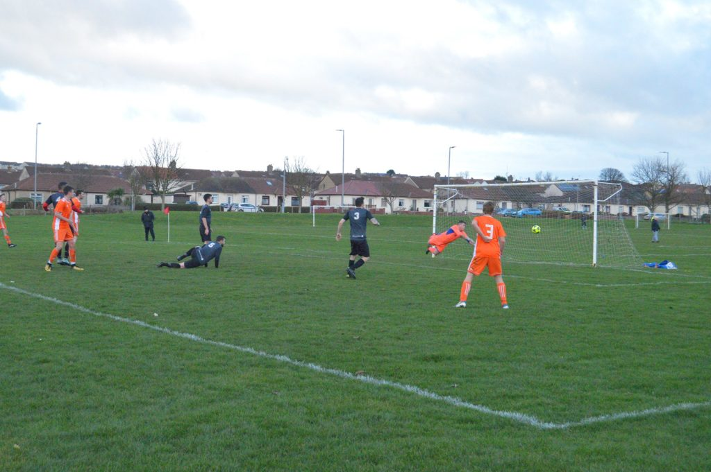 The Galston keeper is kept alert with repeated attempts at goal.
