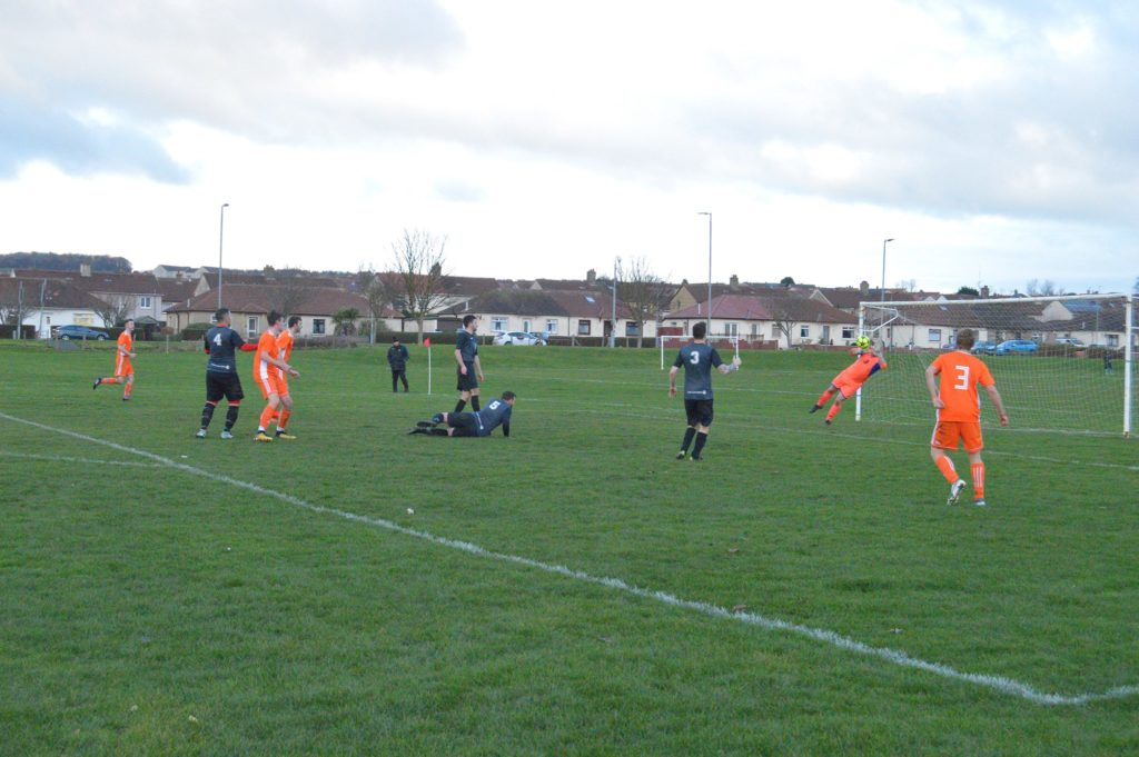 An Arran attempt at goal is thwarted by the Galston keeper.