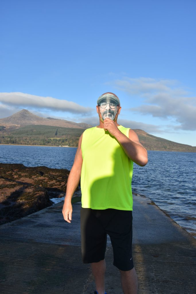 One of the founding dookers, Sean Henry, owner of the Douglas Hotel, was the first into the water with his mask in honour of his unwell friend.