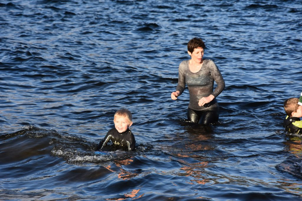 This youngster who brought along a small paddle board was reluctant to leave the water.