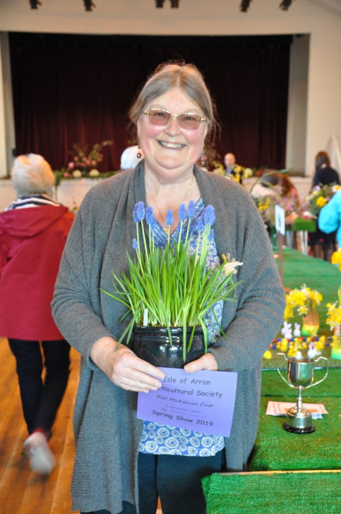 Angela Cassels shows off her Spring bulbs that won her the best exhibit in the category and the RW McKelvie Cup.