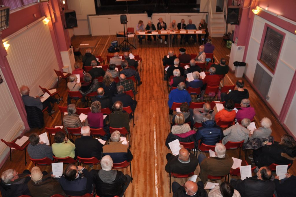 A packed Brodick Hall for the meeting.
