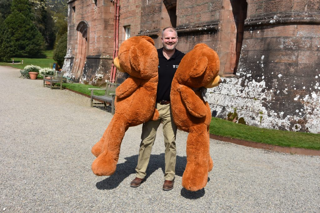 Brodick castle operations manager Jared Bowers with two of the stars of the teddy bear's picnic.