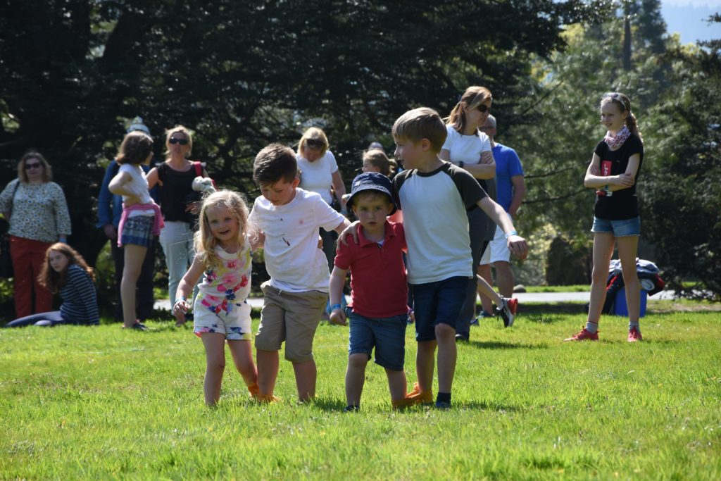Young competitors work together in the three-legged races.