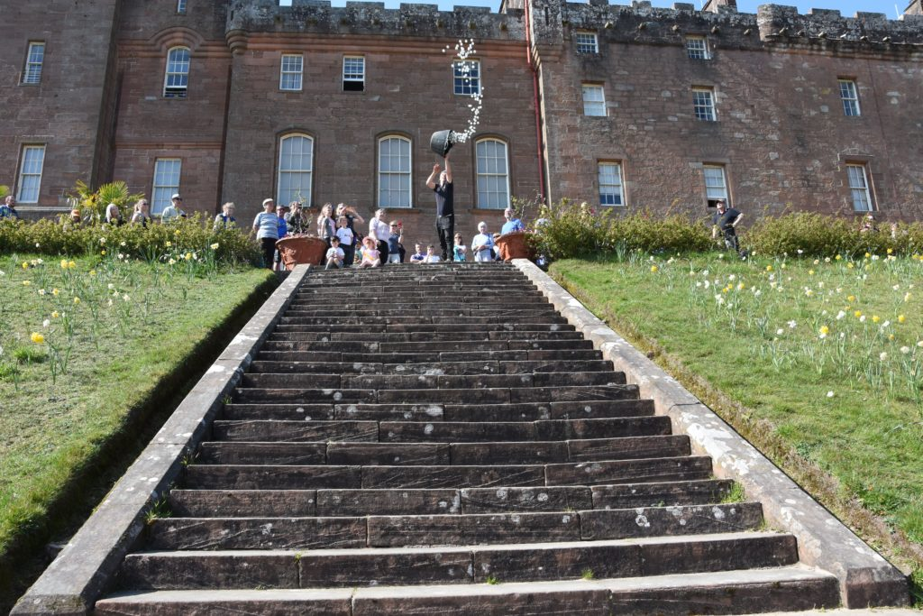 Arran ranger Jackie Kemp throws the balls down the castle stairs in the duck derby.