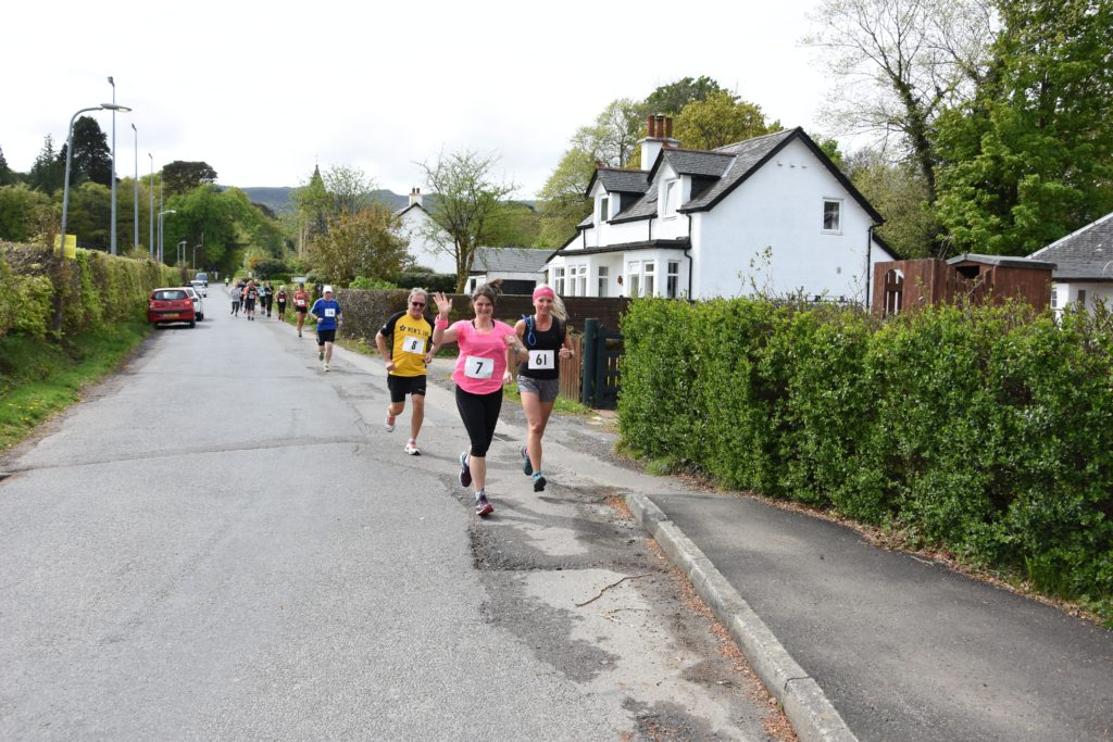Arran runners Lois Bell, Zara Mackay and Hugh Boag are all smiles at the start of the race.