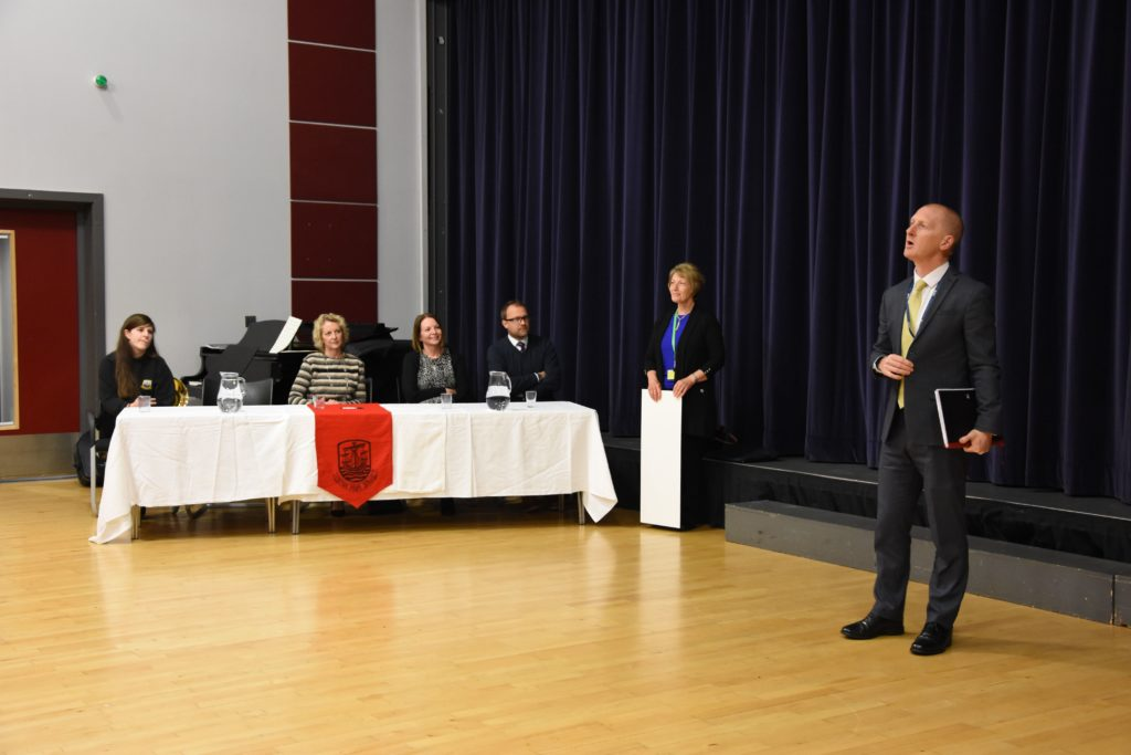 Head teacher Barry Smith announces the winners of the 2019 YPI while the judging panel looks on.