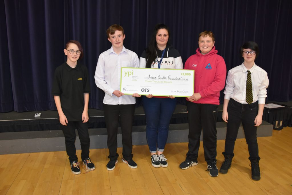 The winning team presents AYF youth worker Hollie Watkins with the cheque that they won for the youth group.