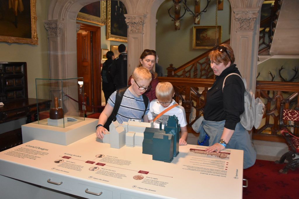 Children enjoy a tactile model of the castle and its additions through the ages.