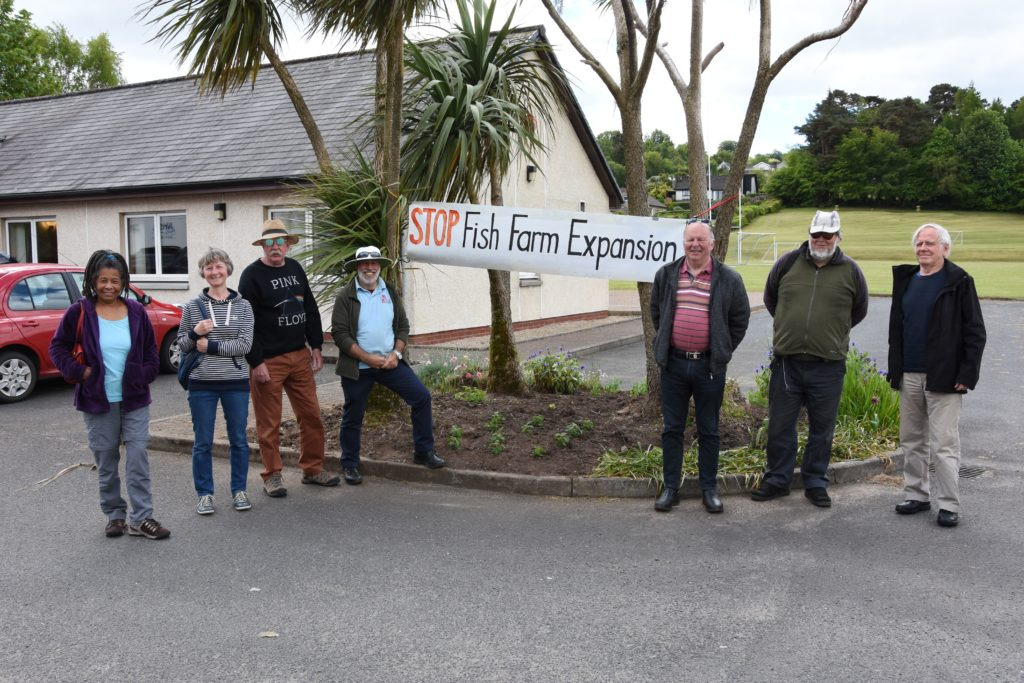 Opponents to the fish farm development held a dignified protest outside the venue and were happy to answer any questions that attendees had.