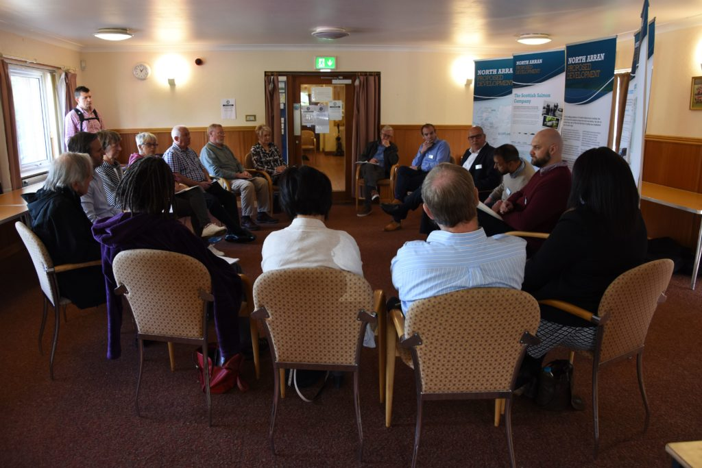 A small group of pre-booked attendees take part in consultation event which was limited to a number of appointments and groups of ten people.