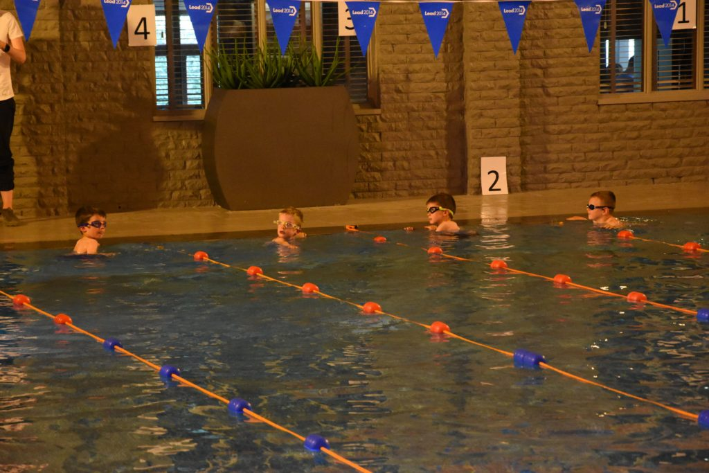 Swimmers at the ready, young boys await their starting orders.
