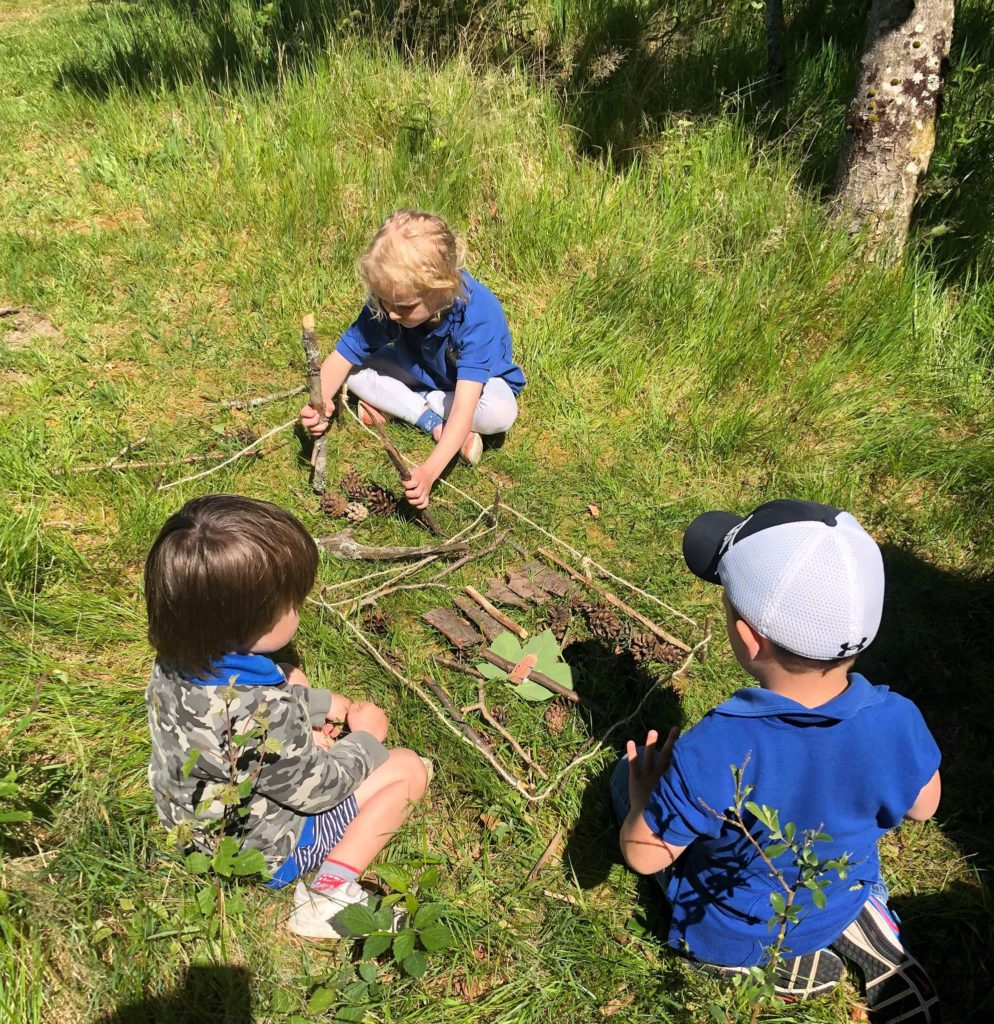 Brodick Early Years pupils with some of their house building materials. Photo: Arran Ranger Service.