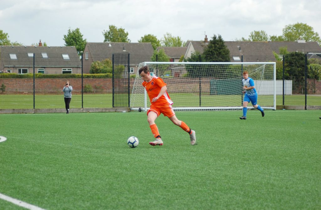 Grant Adamson powers towards the goal to open up the scoring for the Arran side.