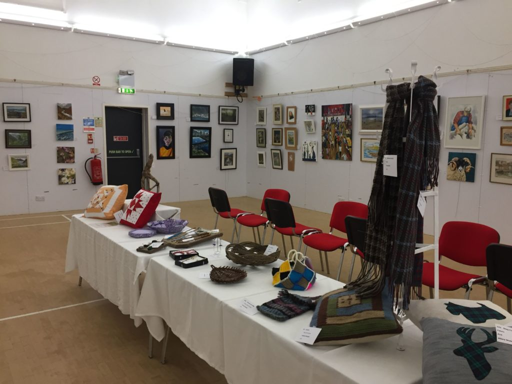 Artworks decorate the walls and tables at last year's Summer Exhibition.