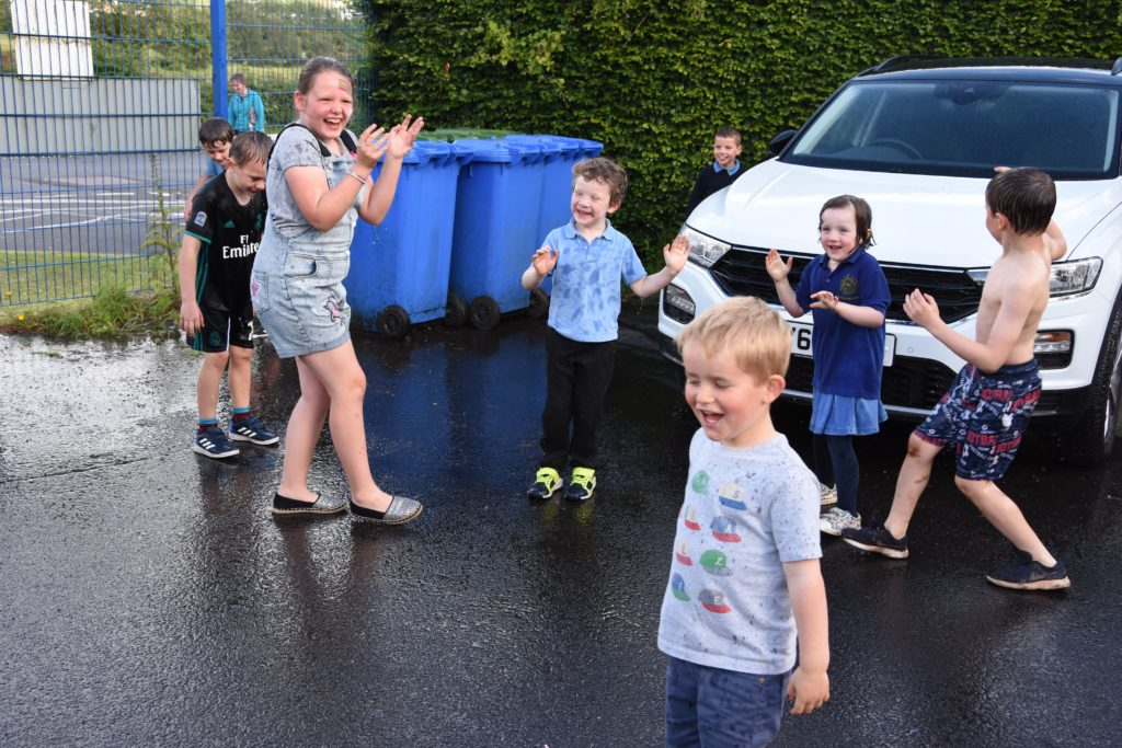 Children enjoy a good soaking in the summer heat.