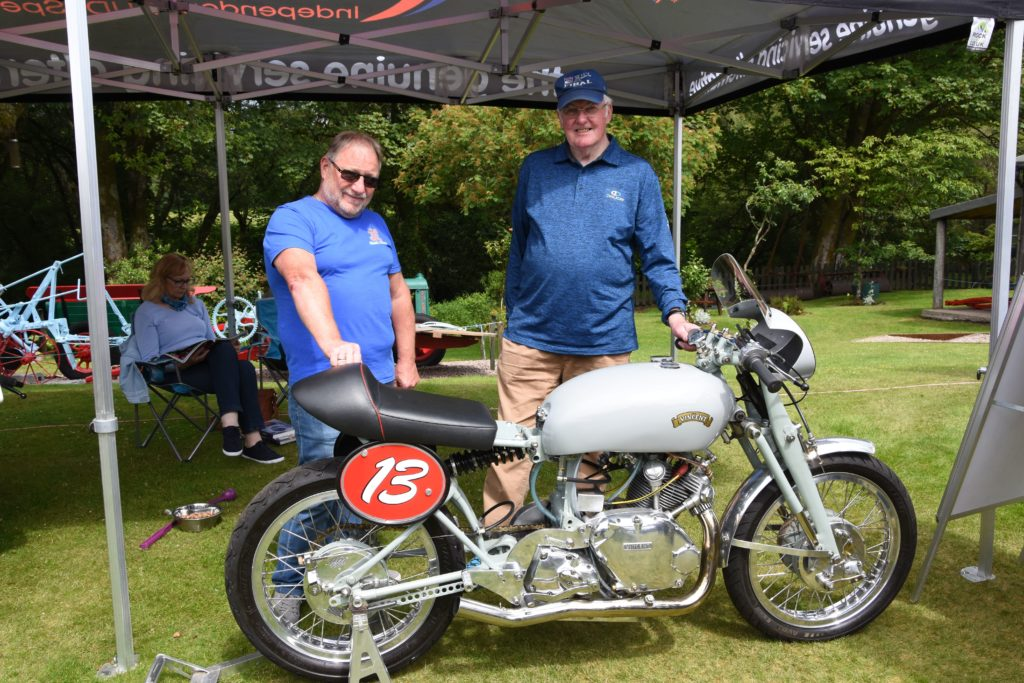 Judges Norrie Pattie and John Hartley cast their eyes over the motorcycles on display.