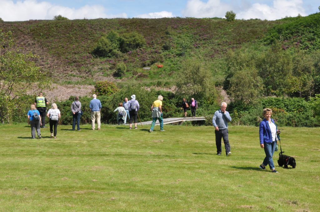 Visitors explore the vast gardens.