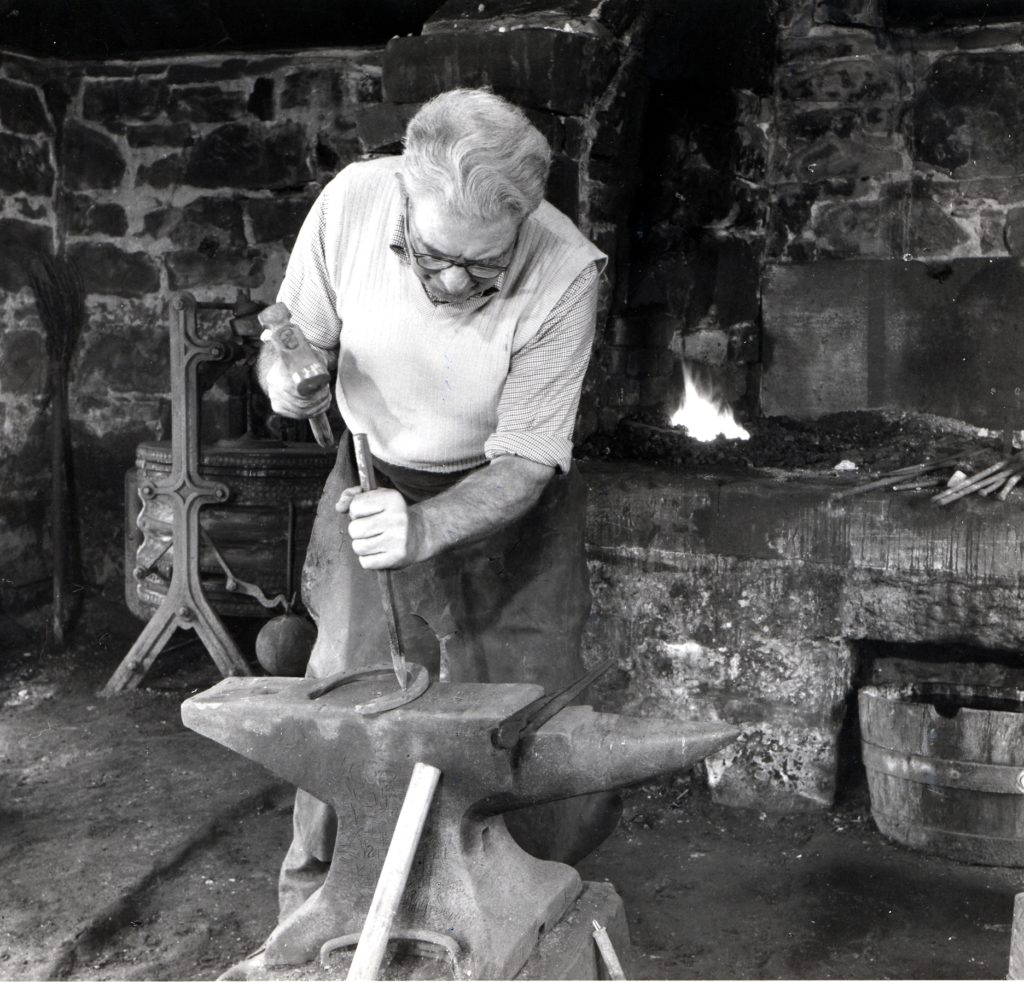 Donald Ferguson at work on a horseshoe in the old smiddy in the early 80s.