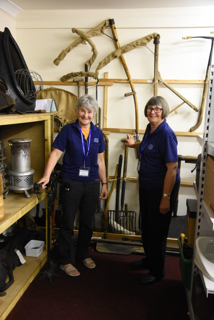 Megan Fyfe and Chris Black showed visitors some of the items in the storeroom that are not on permanent display.