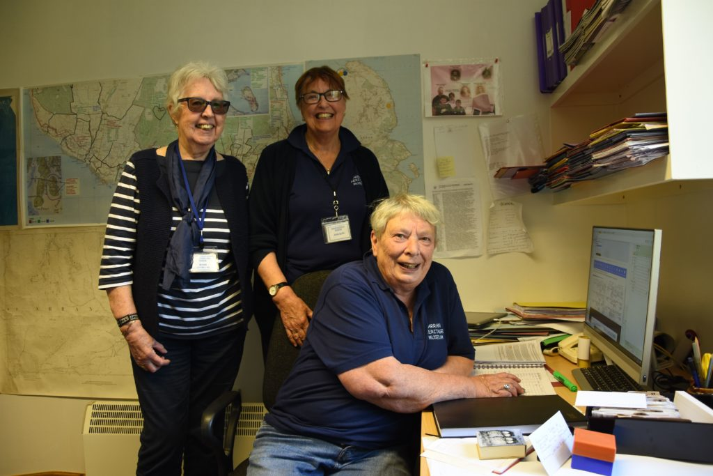 Volunteer researchers Mhairi Macmillan, Jean Glen and Margaret Wright demonstrate the archival resources and information held by the genealogy department.