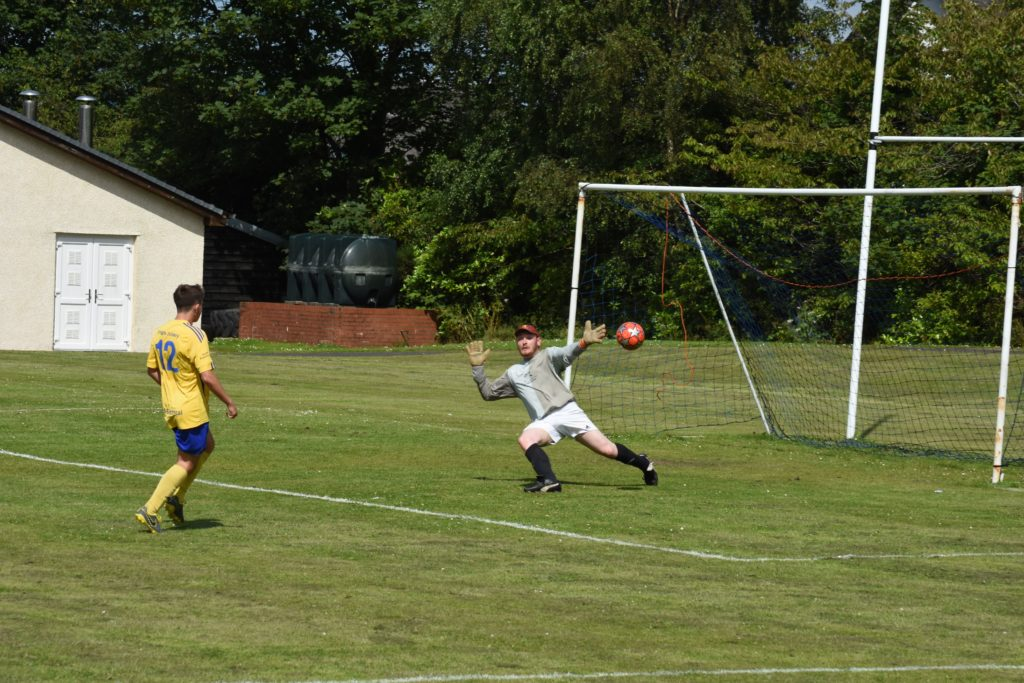 Gregor Chrichton outmanoeuvres the Brodick keeper to secure the first goal for Southend.