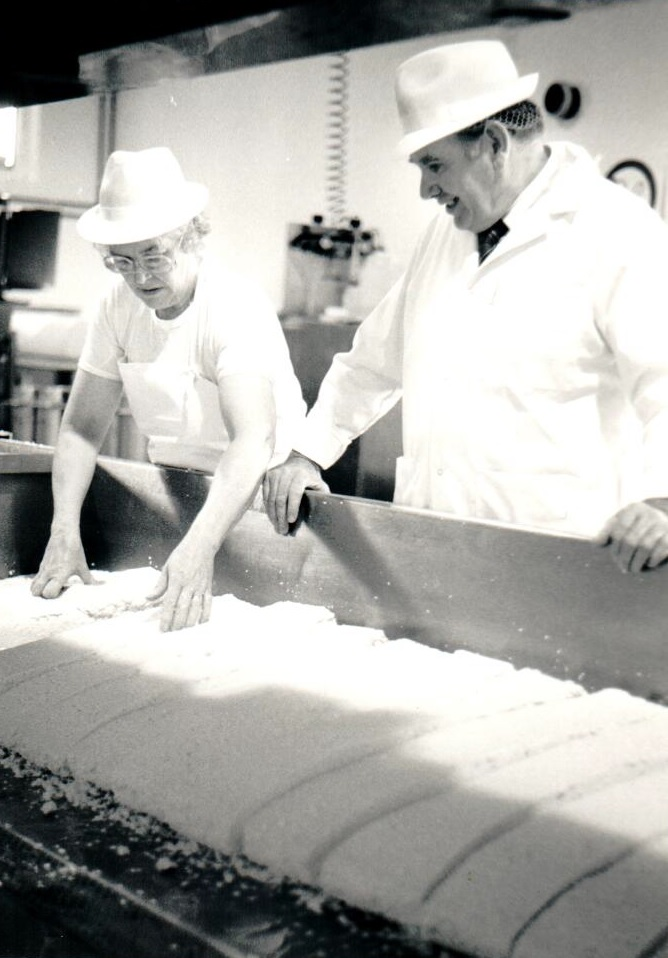Neil McLean and Margaret McIver cut the curds into slabs in 1992.