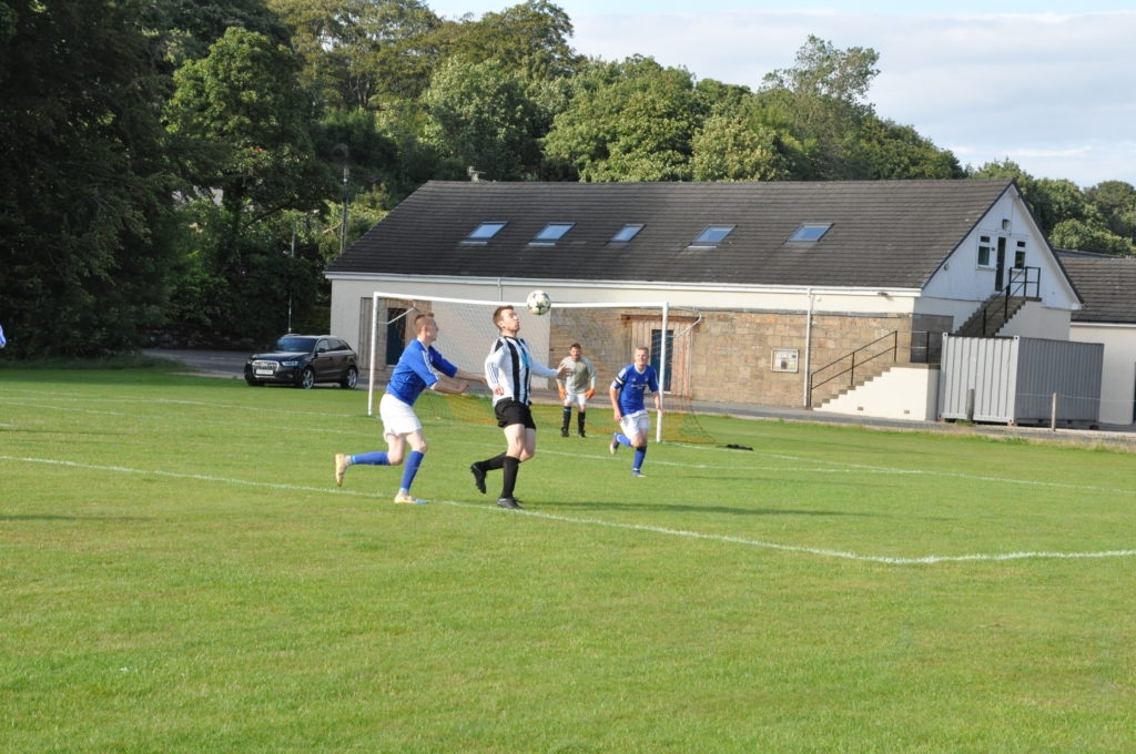 Ben Tattersfield controls the ball on the edge of the Brodick penalty box.