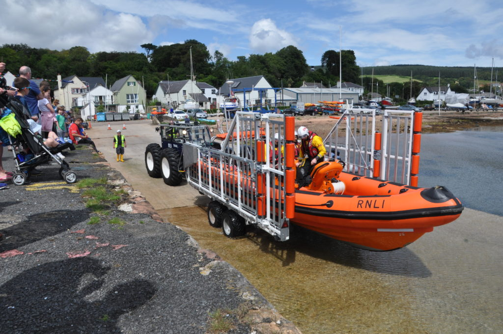 The lifeboat enters the water at Lamlash pier.