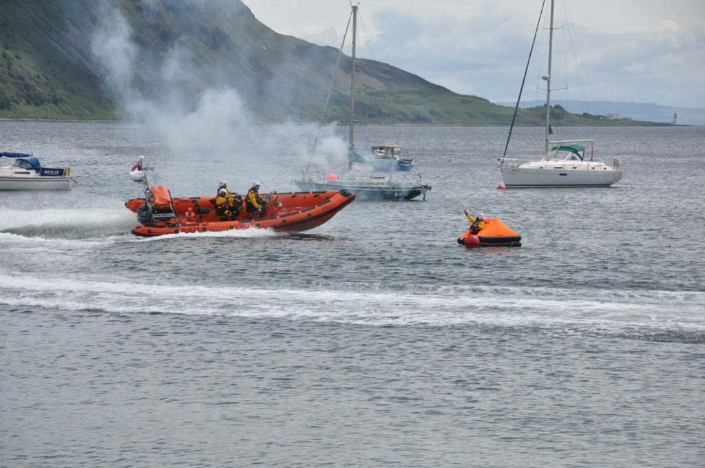 The lifeboat comes to the rescue of a sailor in distress during the display.