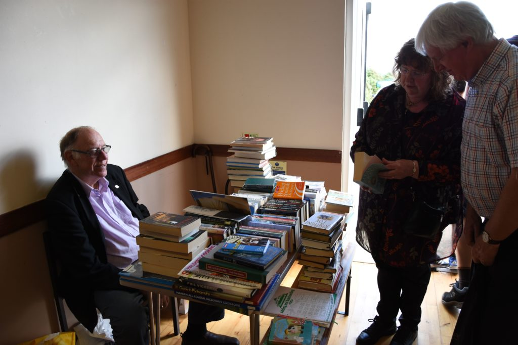 David Hemming invites visitors to browse through the selection of books he has for sale.