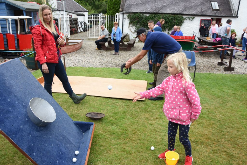 Niamh McNeil impresses mum Emma with her ball throwing accuracy.