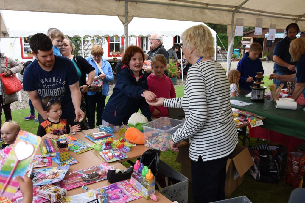 A children's tombola awarded prizes liberally and those that did not win still received a sweet treat.