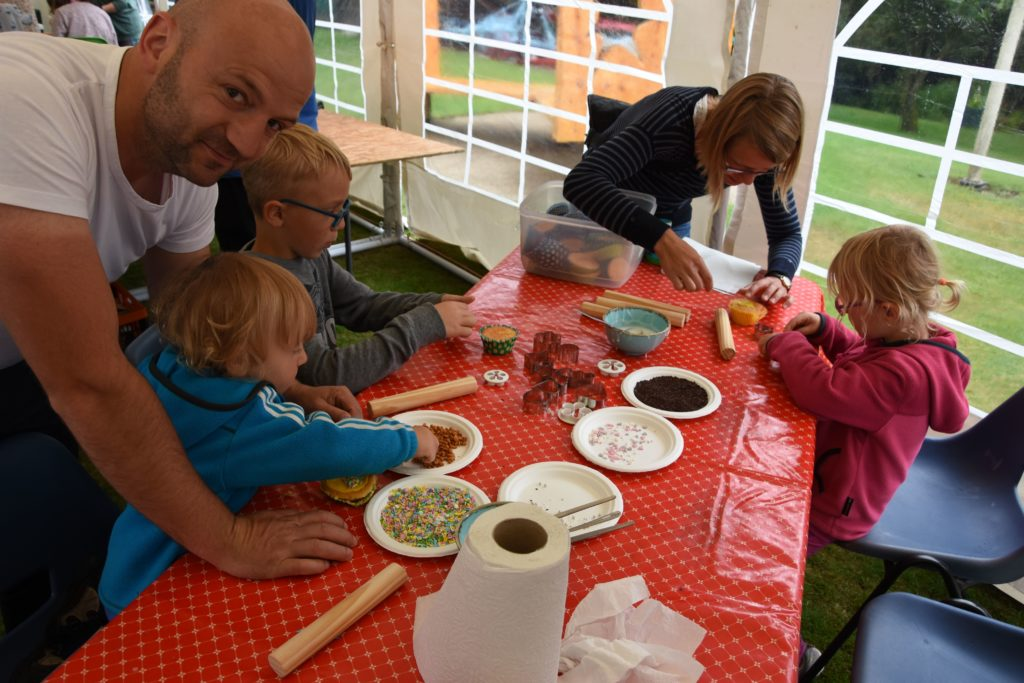 The Hausler family, visiting from Germany, try their hand at cake decorating.