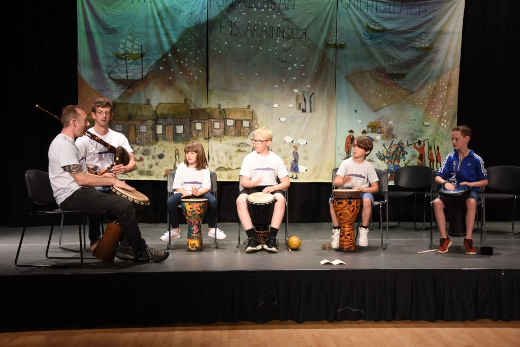 Tin whistle tutor Angus Binnie joins tutor Stevie Fyvie to accompany the drum class performers.