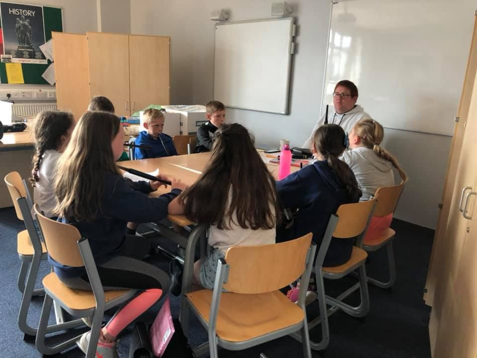 Lorne McDougall teaches pupils the chanter and Pipes.