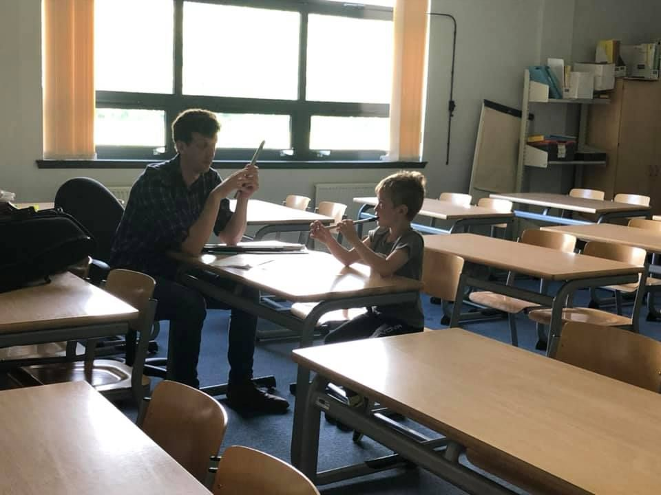 Angus Binnie provides a pupil with a personalised lesson on the tin whistle.