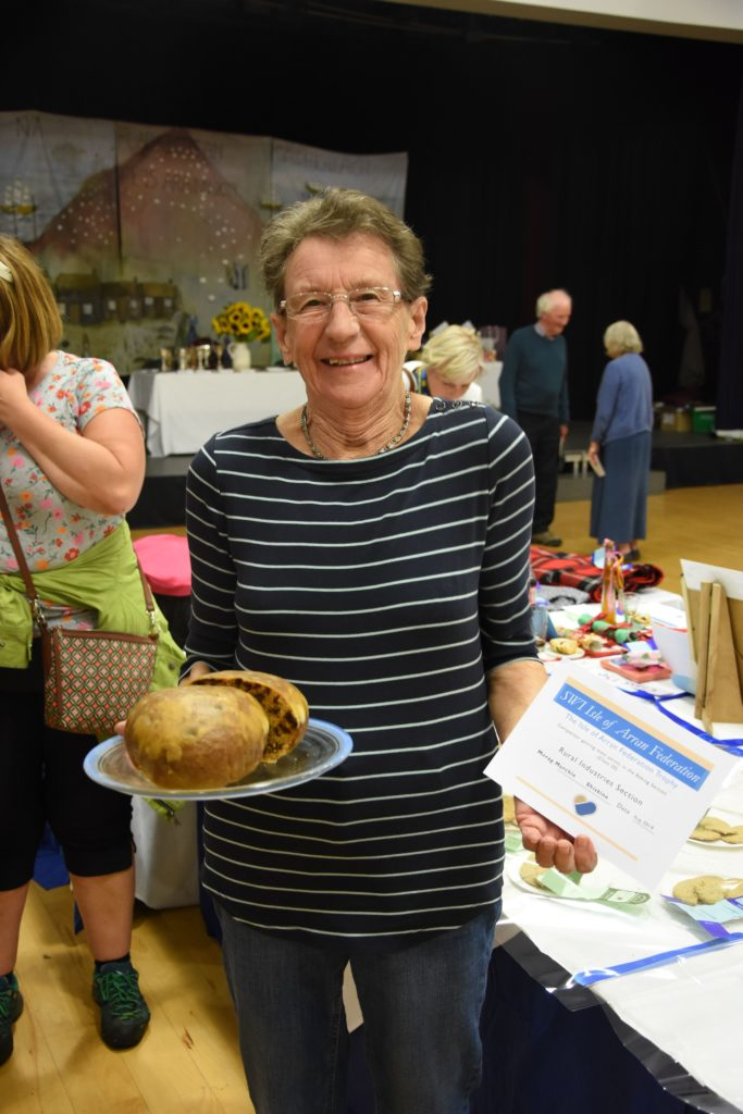 Baker extraordinaire, Morag Murchie shows off her clootie dumpling which earned her the Isle of Arran Federation Trophy for gaining the most points in the baking section.