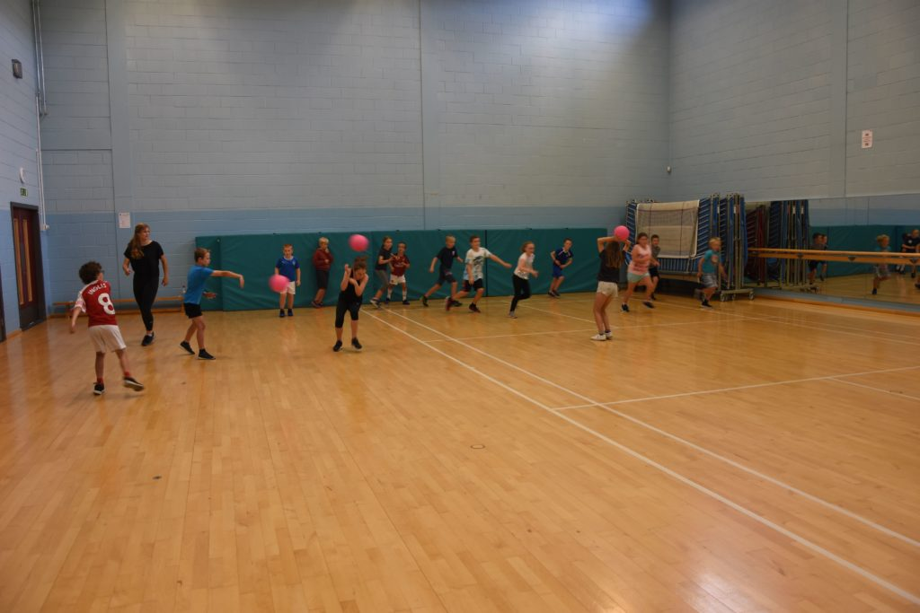 A favourite played with soft balls, children enthusiastically take part in a game of running red rover.