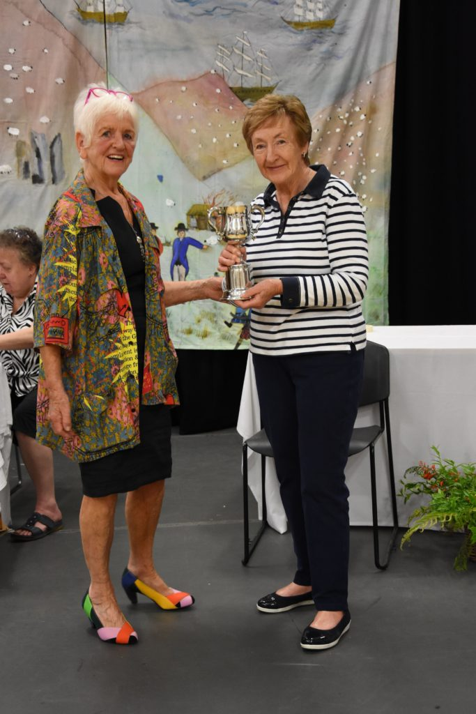 Jan Crawford with the Mairi T Turnbull Trophy for the best exhibit of floral art.
