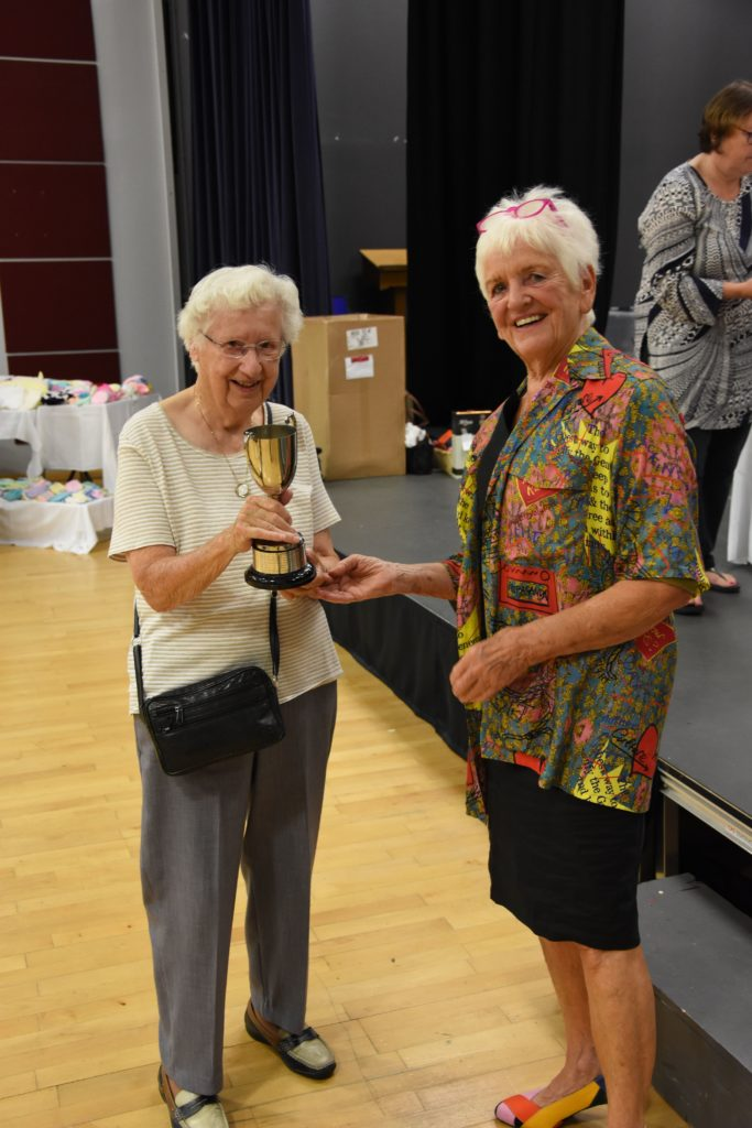 Morag Campbell receives the Kilmory Trophy for the most points gained in the art section.
