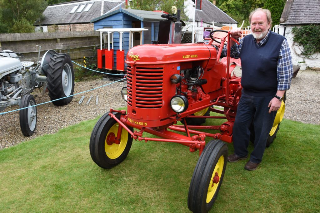First and third place winner in the vintage class, DG Weir, is pictured with another of his vintage tractors, a 1954 petrol powered Massey-Harris Pony 820 which was built in France.