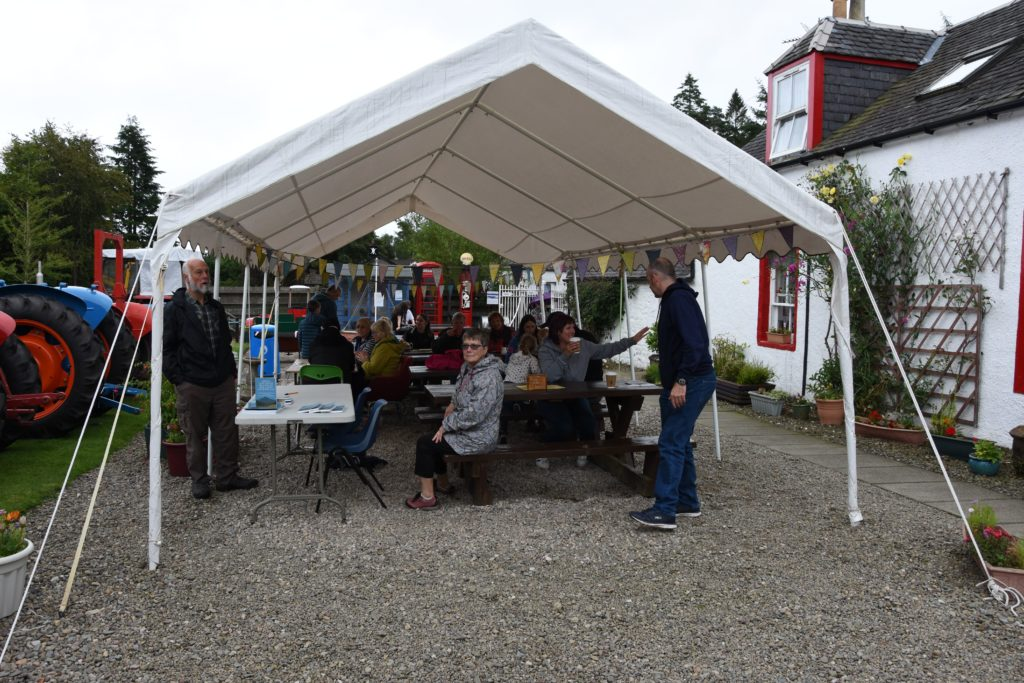 Visitors enjoy a warming drink and lunch under the marquee from Cafe Rosaburn.