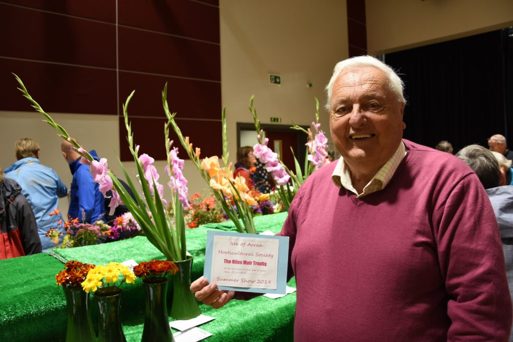 Norman Cuthbert with his Hiles Muir Trophy-winning three spikes of gladioli.