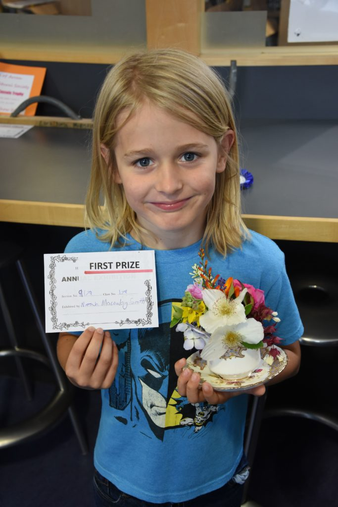 Noah Macaulay-Smith took a first prize for his posy in a teacup.